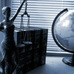 Lawyer figure and a globe of the world